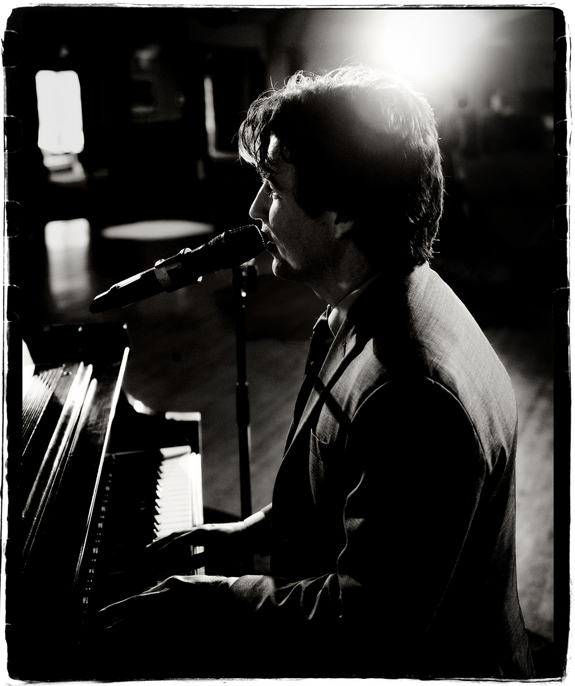 Brent Miller signing and playing piano