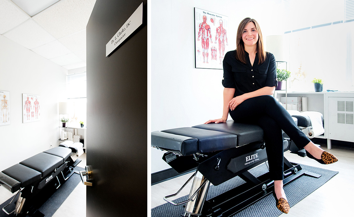 Dr. Lisa Clarke smiles and sits on her chiropractor table