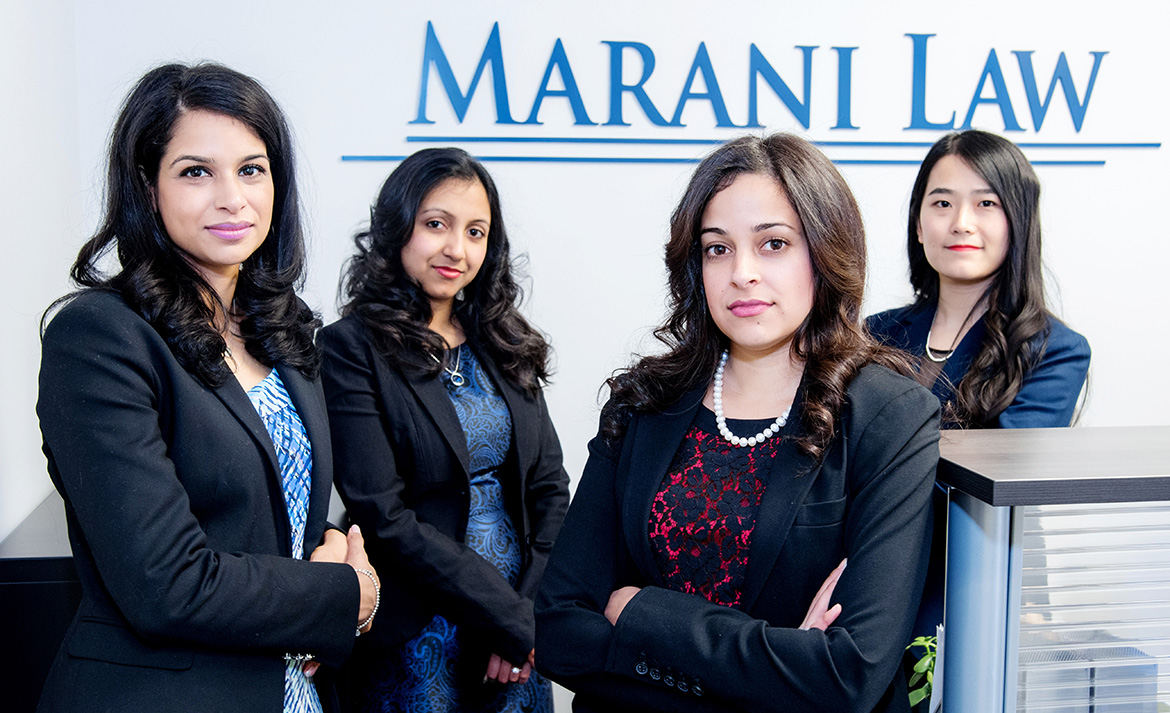 The Marani Law Team with Marani Law Logo in the background