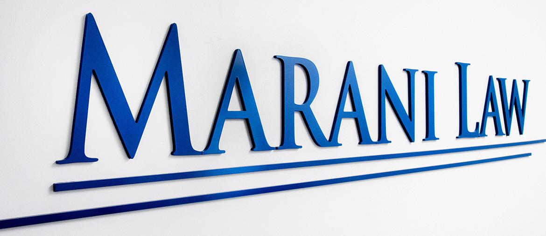 Closeup shot of Marani Law Logo in Reception