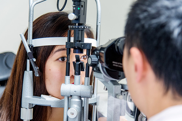 Ophthalmologists Vincent Lam performs an eye examination