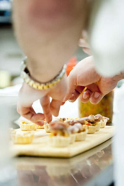 Closeup of kitchen staff preparing hors d'oeuvres