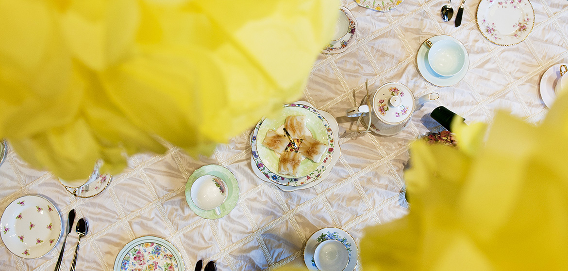 Yellow Flowers above Tea Cups