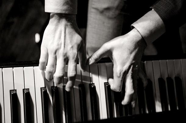 Close up of Brent Miller playing piano