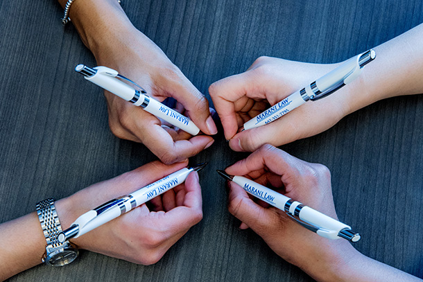 Marani Law Pens held by the Marani Law Team