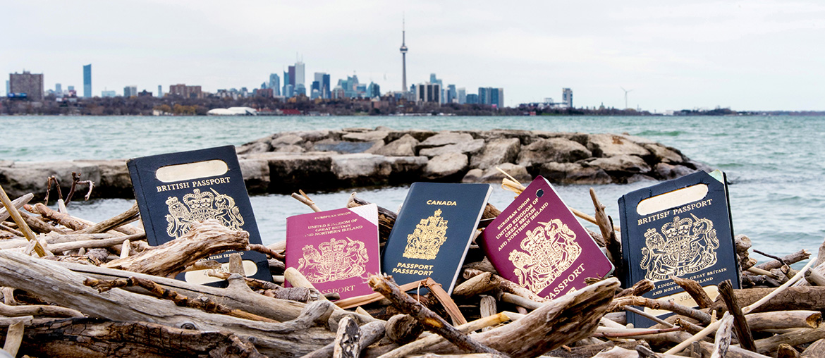 Multiple Passports with the Cn Tower in the background