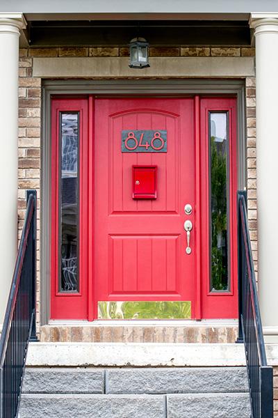 Front door of New Amherst Home in red with dark trim