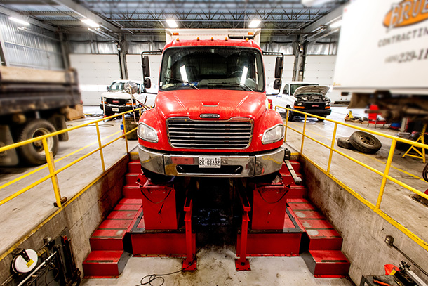 Red Truck inside Auto Shop Repair Pit