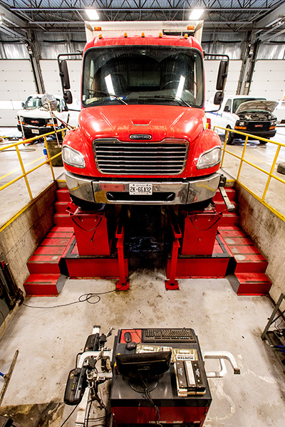 Red Truck in Auto Repair Pit