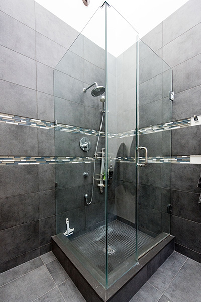 Stand up shower with grey tiles