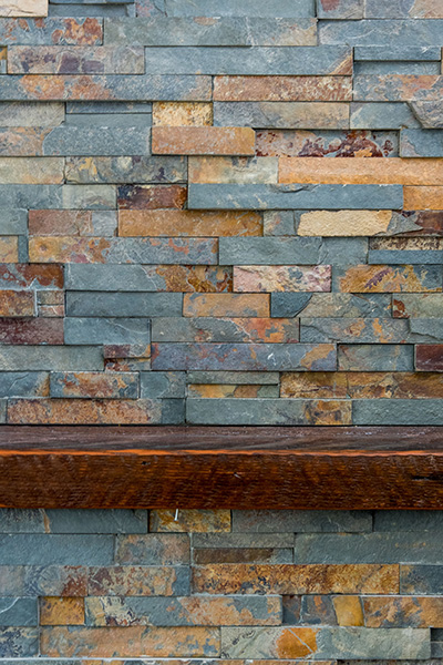 Close up of multi color brick on fireplace