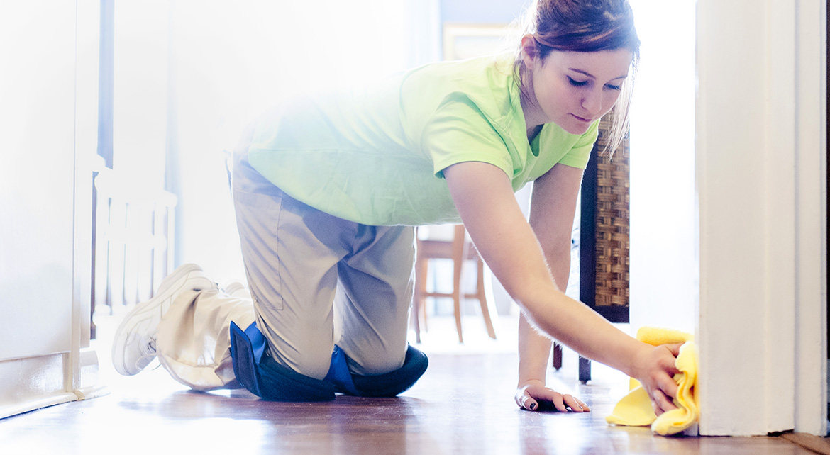 Merry Maid cleaning baseboards