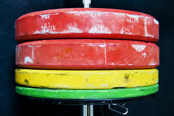 Closeup of red, yellow and green weights