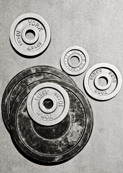 Weights sit on a floor