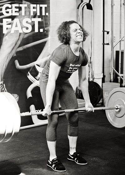 Female participant powerlifts and shows the emotion on her face