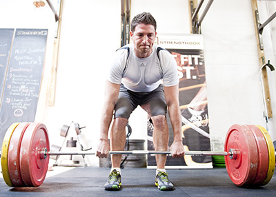 Participant takes stance to powerlift