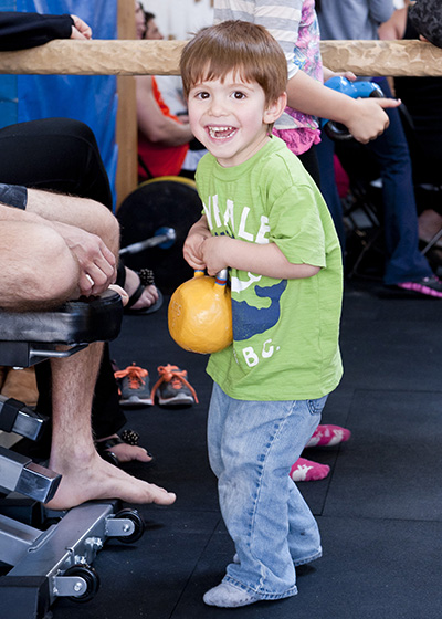 Kids have fun lifting kettlebells