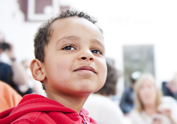 Young boy smiles as he watches the challange