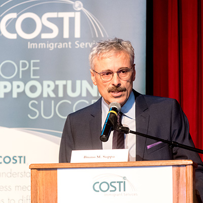Closeup of Mario Calla, Executive Director of Costi at the podium