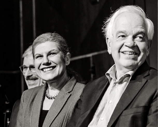 Closeup of John McCallum, Laura Albanese and Mario Calla smiling on stage