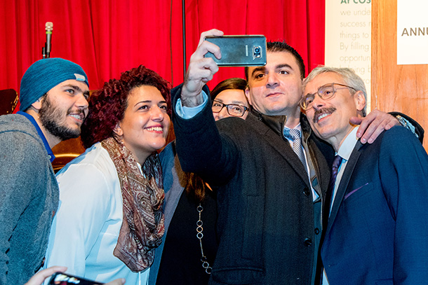 Attendees take a selfie with Mario Calla of Costi