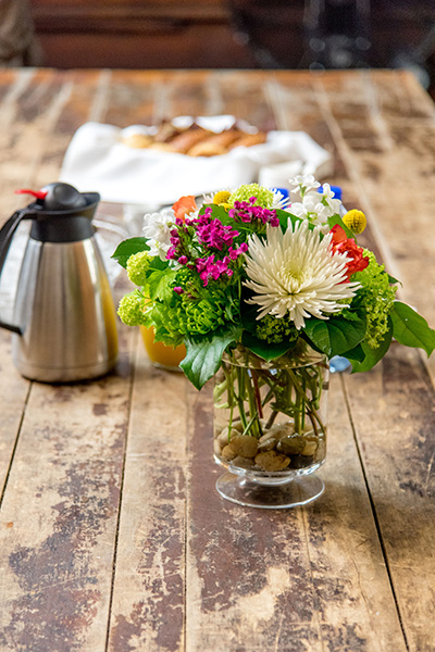 Flowers and Treats welcome guests as they enter