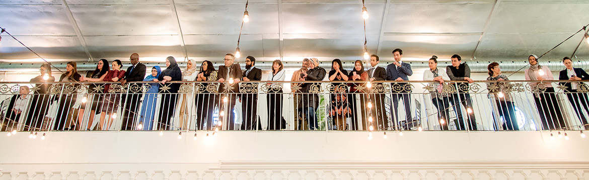 Guests stand on the balcony watching the ceremony