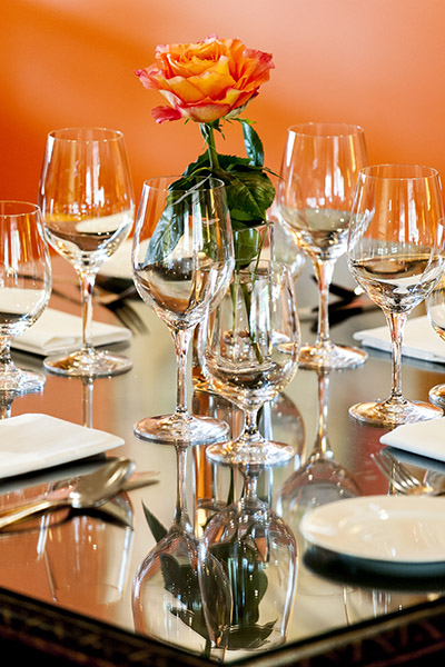 Closeup of Dining Table Setting with Orange Flower