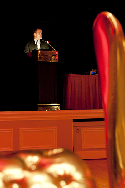 A speaker addresses the guests at the podium