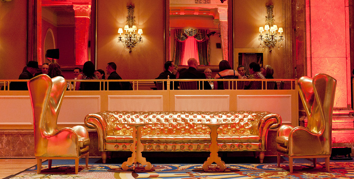 Gold couches and sitting chairs, guests enjoy meals