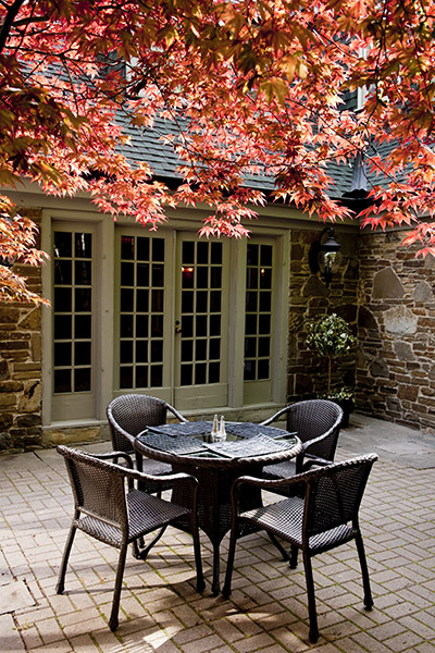 Outside patio seating with double doors in background