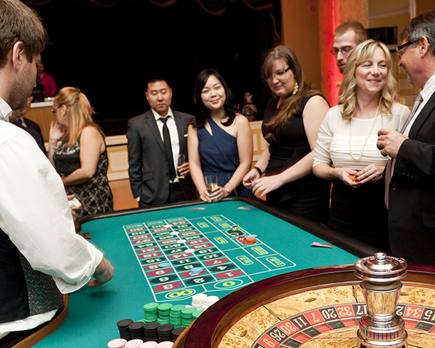 Guests play roulette and smile