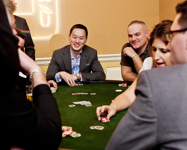 Guests enjoy a game of poker