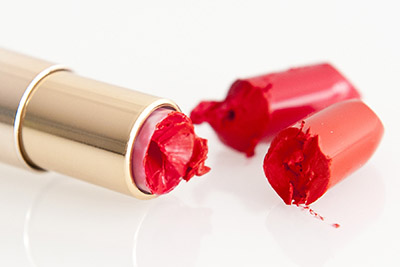 Yves Rocher beauty product photography, bright lipstick in gold case