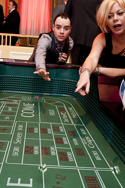 Guests play on the craps table