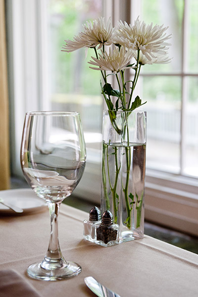 Dinning table flowers and glass