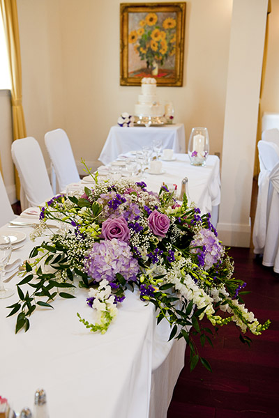 Closeup of large flower arragement on head table