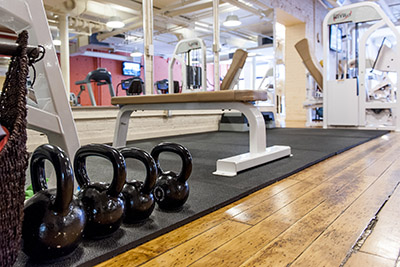 Workout bench and kettle bells inside the gym