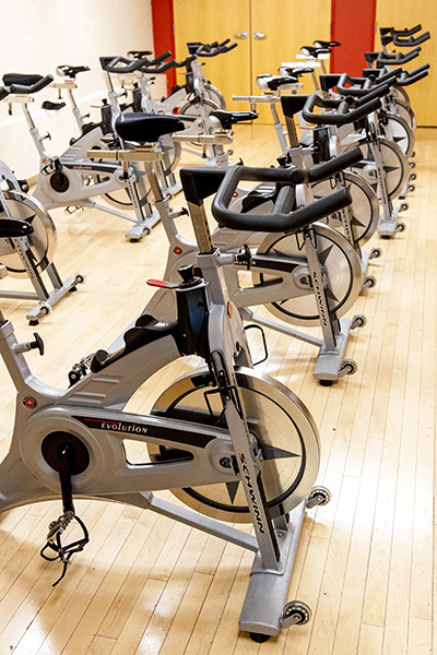 Spin bikes line the gym